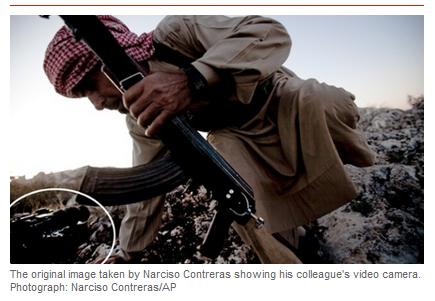 AP sacks Pulitzer winning photog. Zero tolerance or zero intelligence?