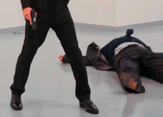 A finger, a trigger, a shoe. A death.